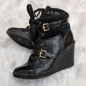 Like new! Michael Kors black & gold wedge sneakers